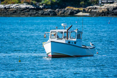 Lobster fishing boat in autumn in coastal Maine, New England Royalty Free Stock Photography
