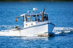 Lobster fishing boat in autumn in coastal Maine, New England Stock Photo