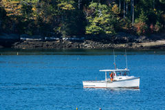 Lobster fishing boat in autumn in coastal Maine, New England Stock Photos