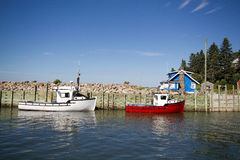 Lobster fishing boats. Colorful fishing boats and cottages at high tide Harbourville,Nova scotia Royalty Free Stock Photos