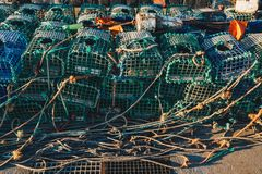 Lobster fishing cages on the shore of a fishing harbour Stock Photos