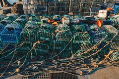 Lobster fishing cages on the shore of a fishing harbour Royalty Free Stock Photos