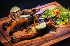 Lobster. Fried lobster on wooden table stock photography