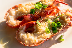 Lobster. With garlic and spring onions royalty free stock photos