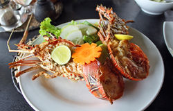 Lobster. Grilled lobster with salad and lemon stock photography