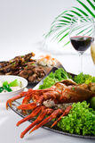 Lobster meal. Cooked large lobster in a bowl with lettuce and lemon and meal stock photos