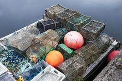 Lobster net pots at harbour on sea jetty for fisherman to catch sea fish and food royalty free stock images