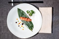 Lobster nigiri on a bamboo leaf, japanese food. Lobster nigiri on a bamboo leaf served with daikon and radish julienne, traditional Japanese food, fresh fish on royalty free stock photo