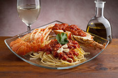 Lobster pasta with tomato sauce stock images