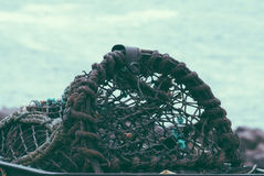 Lobster pot or cage in foreground Stock Image