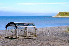 Lobster pot on the shores of Les îles de la Madeleine. Les îles de la Madeleine is a small sand island in the Gulf of the St Lawrence. It`s industry is Royalty Free Stock Photos