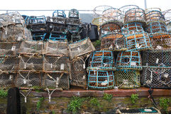 Lobster pots. Lots of lobster and crabbing pots piled up on the quayside Stock Photography