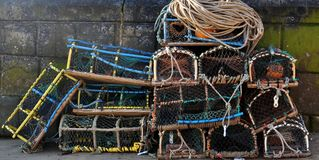 Lobster pots by a sea wall Stock Photography