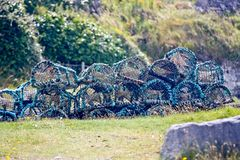 Lobster pots, Aran Island, Ireland. Traps for fishing crayfish and lobster in the harbor of Inisheer, Ireland Royalty Free Stock Photos