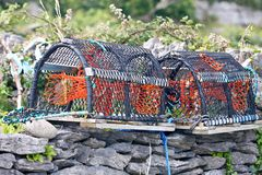 Lobster pots, Aran Island, Ireland. Traps for fishing crayfish and lobster in the harbor of Inisheer, Ireland Royalty Free Stock Photography