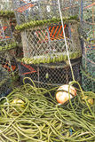 Lobster pots and associated equipment. Trawler fishing nets, ropes and equipment set out on Mudeford Quay, Christchurch, Dorset, England, United Kingdom Royalty Free Stock Photography