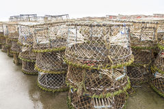 Lobster pots and associated equipment. Trawler fishing nets, ropes and equipment set out on Mudeford Quay, Christchurch, Dorset, England, United Kingdom Royalty Free Stock Images