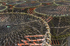 Lobster pots and associated equipment. Trawler fishing nets, ropes and equipment set out on Mudeford Quay, Christchurch, Dorset, England, United Kingdom Stock Photography