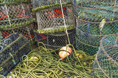 Lobster pots and associated equipment. Trawler fishing nets, ropes and equipment set out on Mudeford Quay, Christchurch, Dorset, England, United Kingdom Stock Images