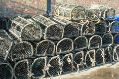 Lobster pots. Brightly coloured lobster pots stacked on a quayside Stock Image