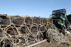 Lobster pots and fishing nets Stock Photos