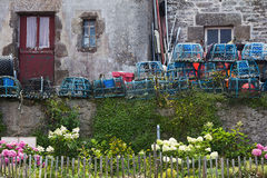 Lobster pots in front of a stone house Royalty Free Stock Photos