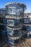 Lobster pots on Hastings fishing quarter stade at Rockanore in East Sussex, England. Commercial fishing lobster pots ready for use in the busy fishing quarter at royalty free stock photo
