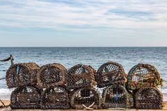 Lobster Pots. Lined up on a beach, on the Isle of Wight royalty free stock photos