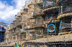 Lobster pots. Pile of lobster pots on the quay side in torquay stock photos
