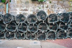 Lobster pots piled up in the harbour Stock Photo
