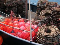Lobster Pots and Red Floats on Boat Deck, Hobart, Tasmania. Pots or traps used to catch lobsters, or crayfish, and red floats on the deck of a boat, Hobart Royalty Free Stock Photography