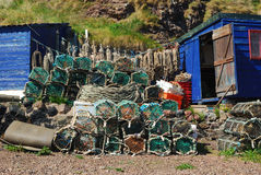 Lobster pots, ropes, boxes and hut at St. Abbs harbour Royalty Free Stock Image