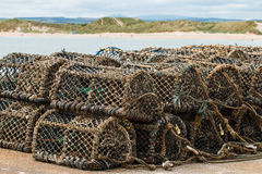 Lobster pots in sandy bay Royalty Free Stock Photography