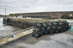 Lobster pots stacked in a Harbour Stock Photography