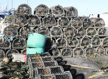 Lobster pots stored on the harbor. royalty free stock images