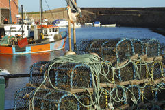 Lobster pots and trawlers at Dunbar harbour Stock Photos