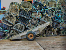 Lobster pots with trolley for moving them around the harbour Royalty Free Stock Photography