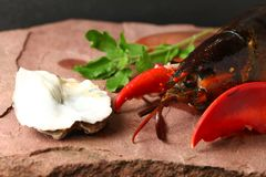 Lobster put on the stone plate. Lobster put on the stone plate represent seafood menu Royalty Free Stock Images
