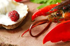 Lobster put on the stone plate. Lobster put on the stone plate represent seafood menu Royalty Free Stock Image