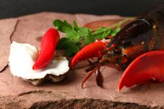 Lobster put on the stone plate. Lobster put on the stone plate represent seafood menu Stock Photography
