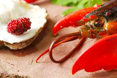 Lobster put on the stone plate. Lobster put on the stone plate represent seafood menu Stock Image