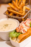 Lobster Roll and Bisque with French Fries Royalty Free Stock Photo