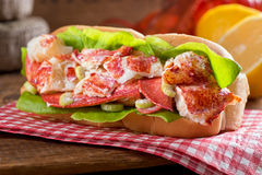 Lobster Roll. A delicious freshly made lobster roll with lobster, lemon, celery, and mayonnaise Royalty Free Stock Images