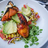 Lobster Salad. Char-grilled corn, tomato, avocado and cilantro Royalty Free Stock Image