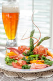 Lobster Salad presentation with local strong ale - red and green. Stock Photography