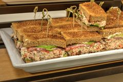 Lobster salad sandwich with avocado and the crust at a lunch buffet stock photo