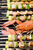 Lobster and Salmon Veggie Skewers. Lobster and fish skewers are on the barbecue Stock Images
