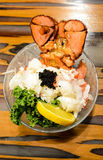 Lobster Sashimi. With black tobiko flying fish roe, lemon and kale stock image