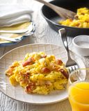 Lobster Scrambled Eggs. A plate of delicious lobster scrambled eggs with chives Stock Image