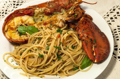 Lobster with spaghetti on white plate. Royalty Free Stock Photography